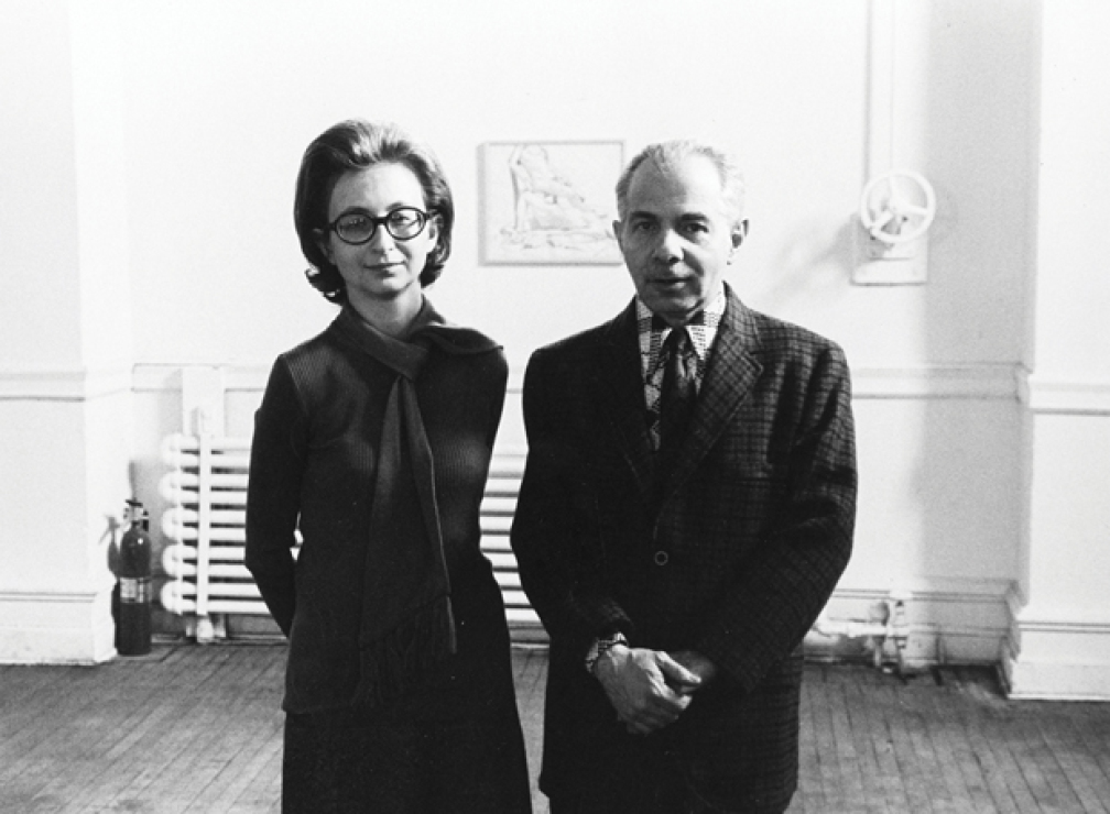 Dorothy and Herbert Vogel at The Clocktower with a drawing by Philip Pearlstein behind them, 1975.