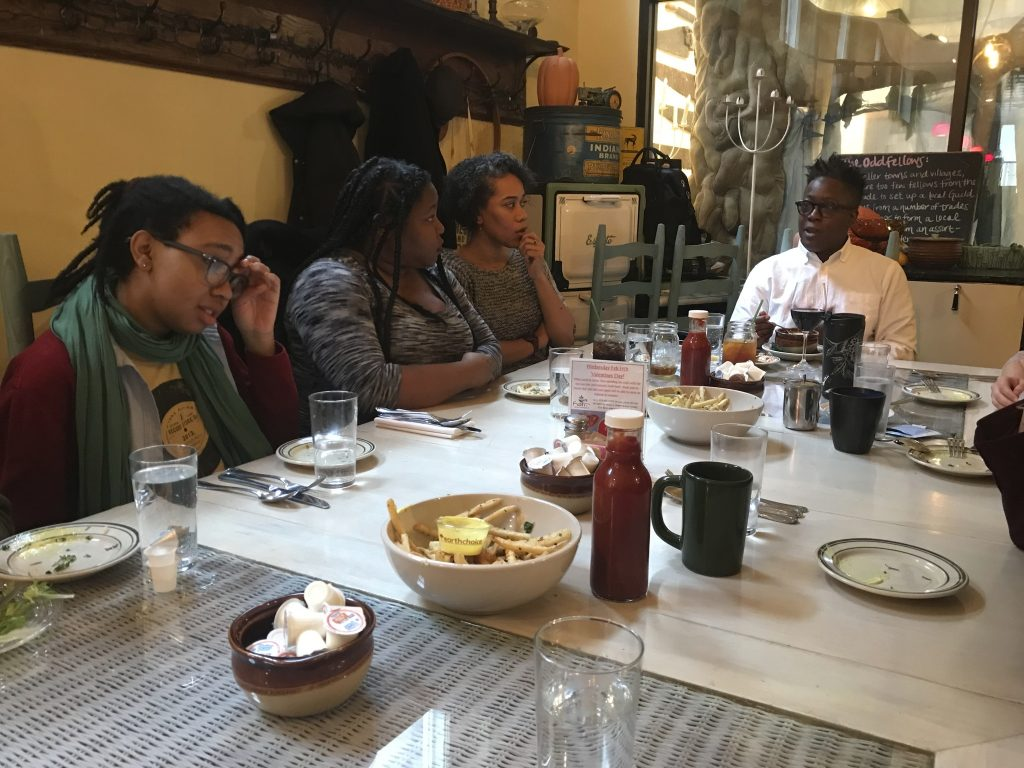 Noni (far left) at lunch with guest filmmaker Cheryl Dunye (far right)