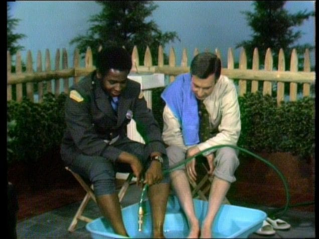 Mister Rogers and Officer Clemmons cooling off in the pool.