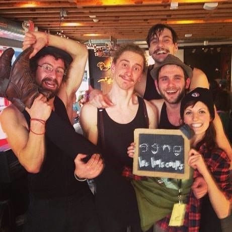 Caitlyn Stevens with with the French musical group Les Trois Coups, who had traveled from France to busk that year.