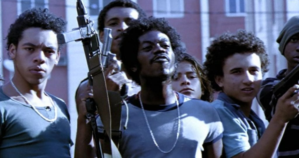 Leandro Firmino as Lil' Ze with his allies in City of God (2002)