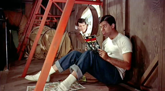 "Lewis reading a ""Bat Lady"" comic book"