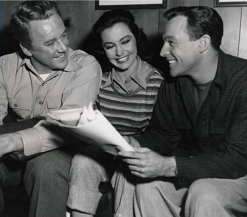 Van Johnson, Cyd Charisse, and Gene Kelly on the set of Brigadoon