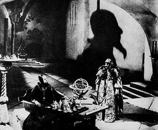 A notably expressionistic shot from the film, featuring Nikolay Cherkosav in the title role (seated)