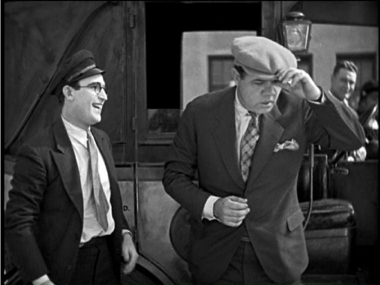 Babe Ruth with Harold Lloyd in Speedy (1928).
