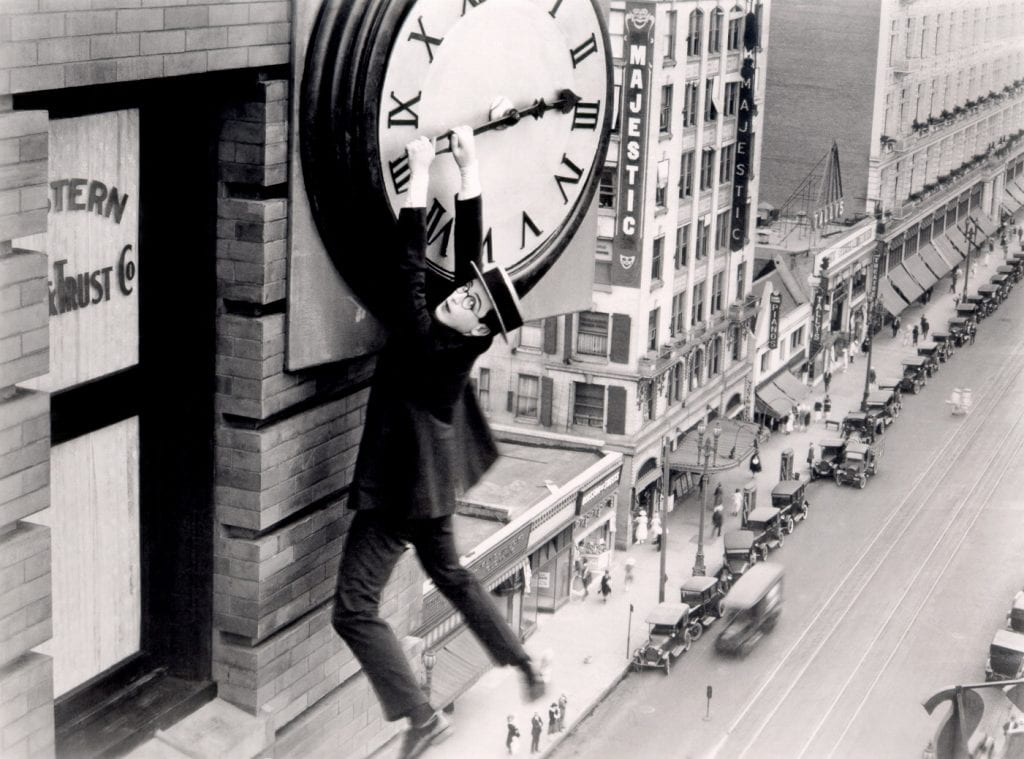 Harold Lloyd hanging from a clock in Safety Last! (1923)