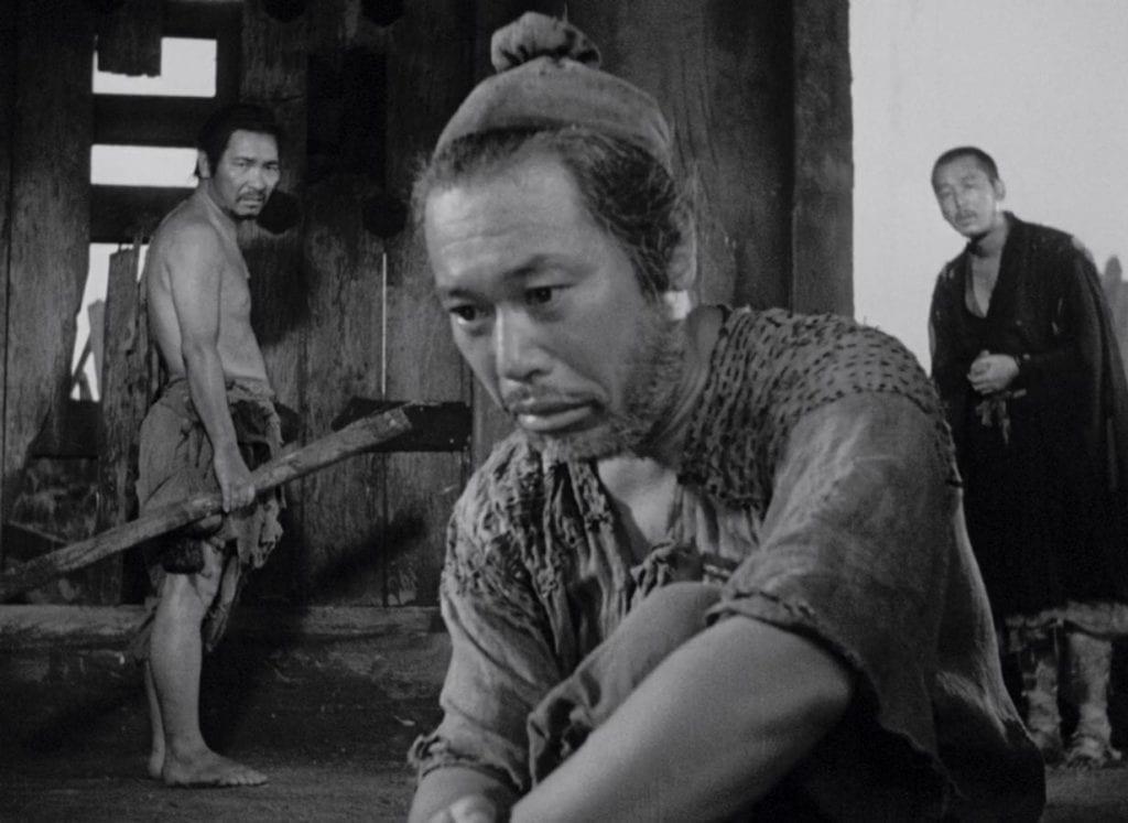 The Priest (Minoru Chiaki), The Woodcutter (Takashi Shimura), and The Commoner (Kichijiro Ueda).