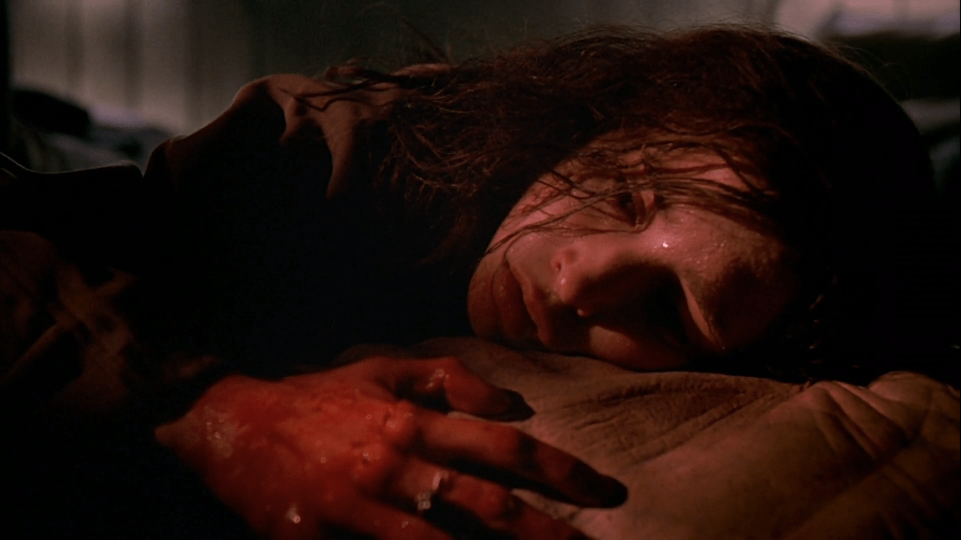 screenshot of Bridgette laying on Gingerwolf in Ginger Snaps