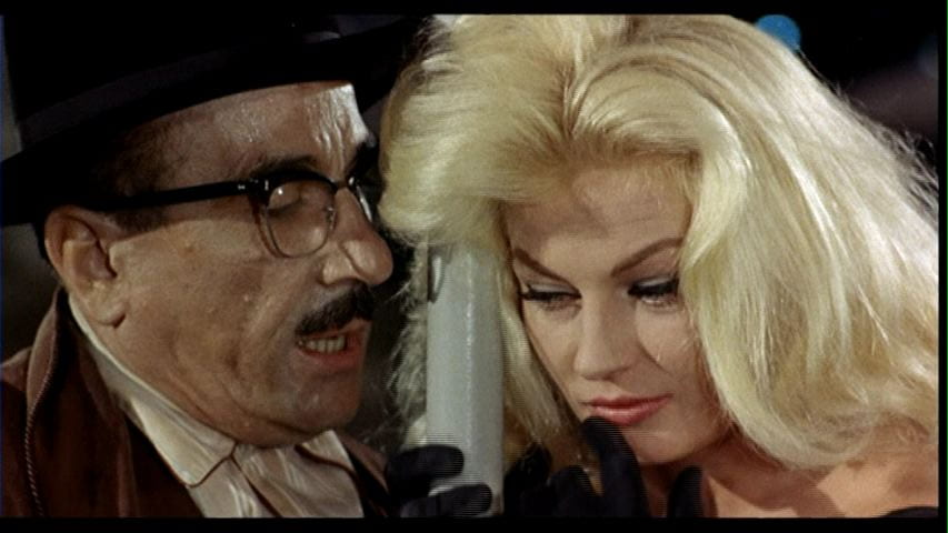 Peppino De Filippo and Anita Ekberg in The Temptation of Doctor Antonio (1962).
