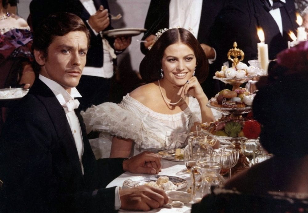 Alain Delon and Claudia Cardinale as Tancredi and Anjelica in a dinner scene from The Leopard.