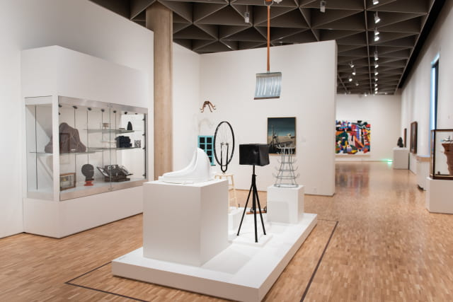 Installation shot of the Eskenazi Museum of Art's rare complete set of Duchamp's Readymades in the Sidney and Lois Eskenazi Gallery, first floor.