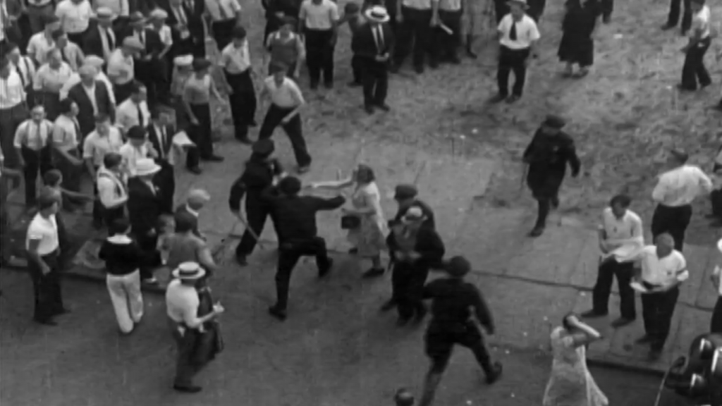 Historical footage from a birds-eye view of an early 20th-century protest