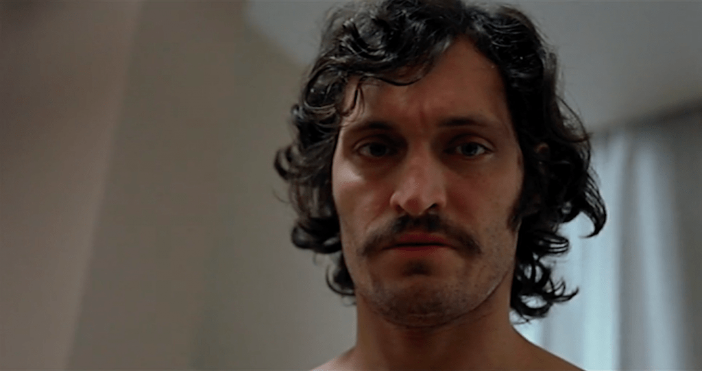 low-angled close up of Vincent Gallo