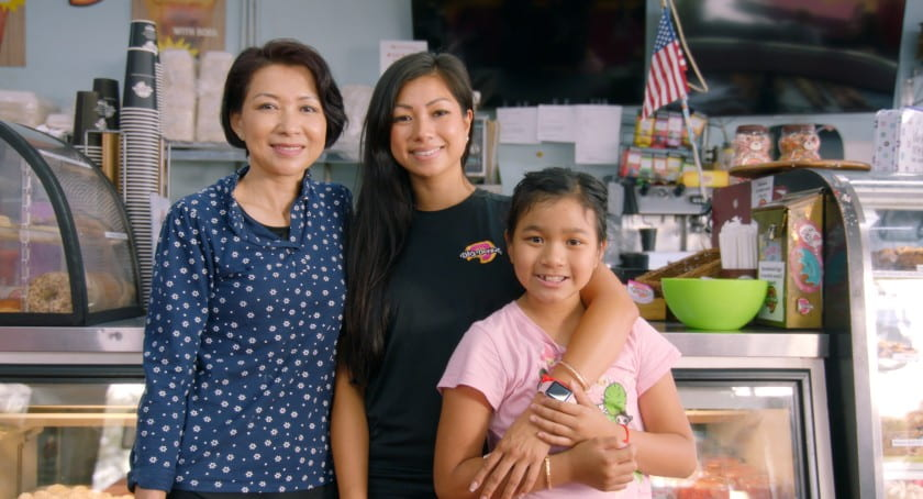Chuong Lee Tao (left) with daughter Mayly (center) at their shop, DK's Donuts, in Santa Monica