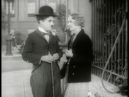 Chaplin (left) and Virginia Cherrill (right) in City Lights (1931), which receives extensive treatment in the documentary