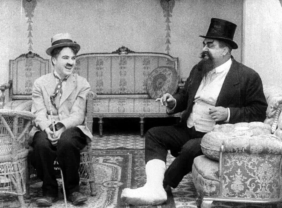 Chaplin (left) and Eric Campbell (right) in The Cure (1917)