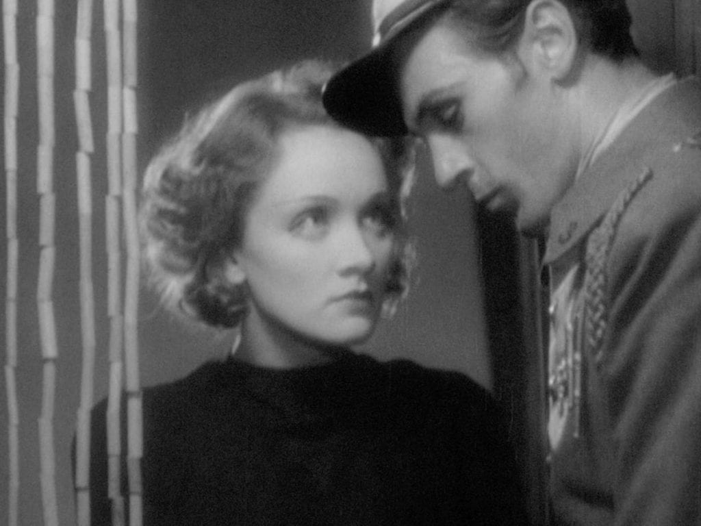 Dietrich (left) and co-star Gary Cooper (right) in Morocco (1930)