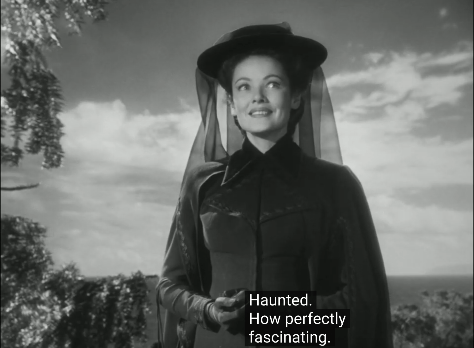 A wide-eyed Gene Tierney in The Ghost and Mrs. Muir