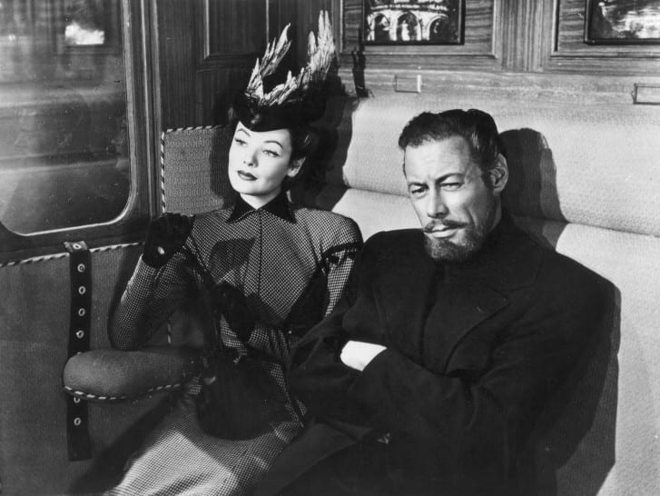 Gene Tierney and Rex Harrison on a train