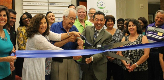 Individuals cutting the ceremonial ribbon (L to R): Cindy Brief, President/CEO of Coral Springs Chamber of Commerce; Lou Cimaglia, City Commissioner of Coral Springs; Wilson Aihara, President/CFO of Green Light Home Care.