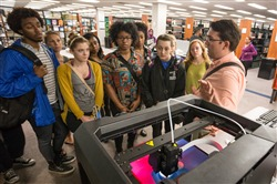 Emerging Technologies Librarian Cody Behles instructs students about 3D printing in McWherter Library Memphis Daily News, Tuesday, September 16, 2014