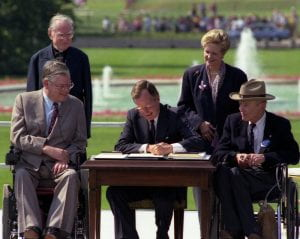 President George H.W. Bush signs the Americans with Disabilities Act