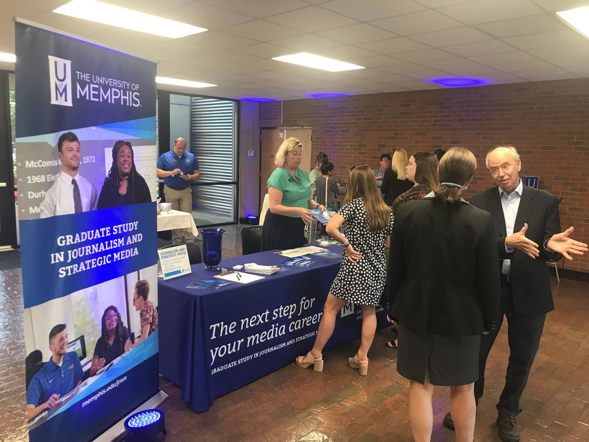 David Arant, chair of Journalism and Strategic Media, discusses graduate programs with UofM Graduate School Dean Robin Poston at an informational open house on July 23 in the Meeman Journalism Building.