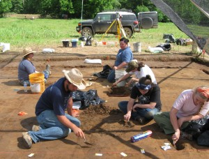 6 Students excavating interior features at Structure 1.