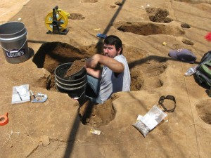 A pensive Scott Hadley excavating a large central post feature in Structure 1.