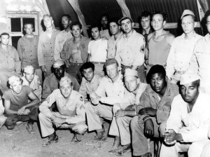 Stressing the need for interracial solidarity in the post-war world, African-American and white soldiers got together as part of the army's general educational program at a heavy bomber base in Italy. March 1945.