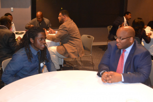 Ed Harper, Hooks Institute Board Member and HAAMI mentor, speaking with a HAAMI student at the 2015 HAAMI reception.