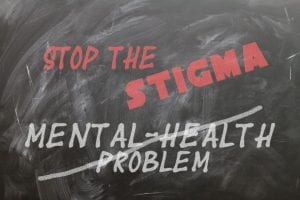 "Chalkboard with words ""Stop the Sigma, Mental Health Problems."" Mental Health problems has a diagonal strike through it."