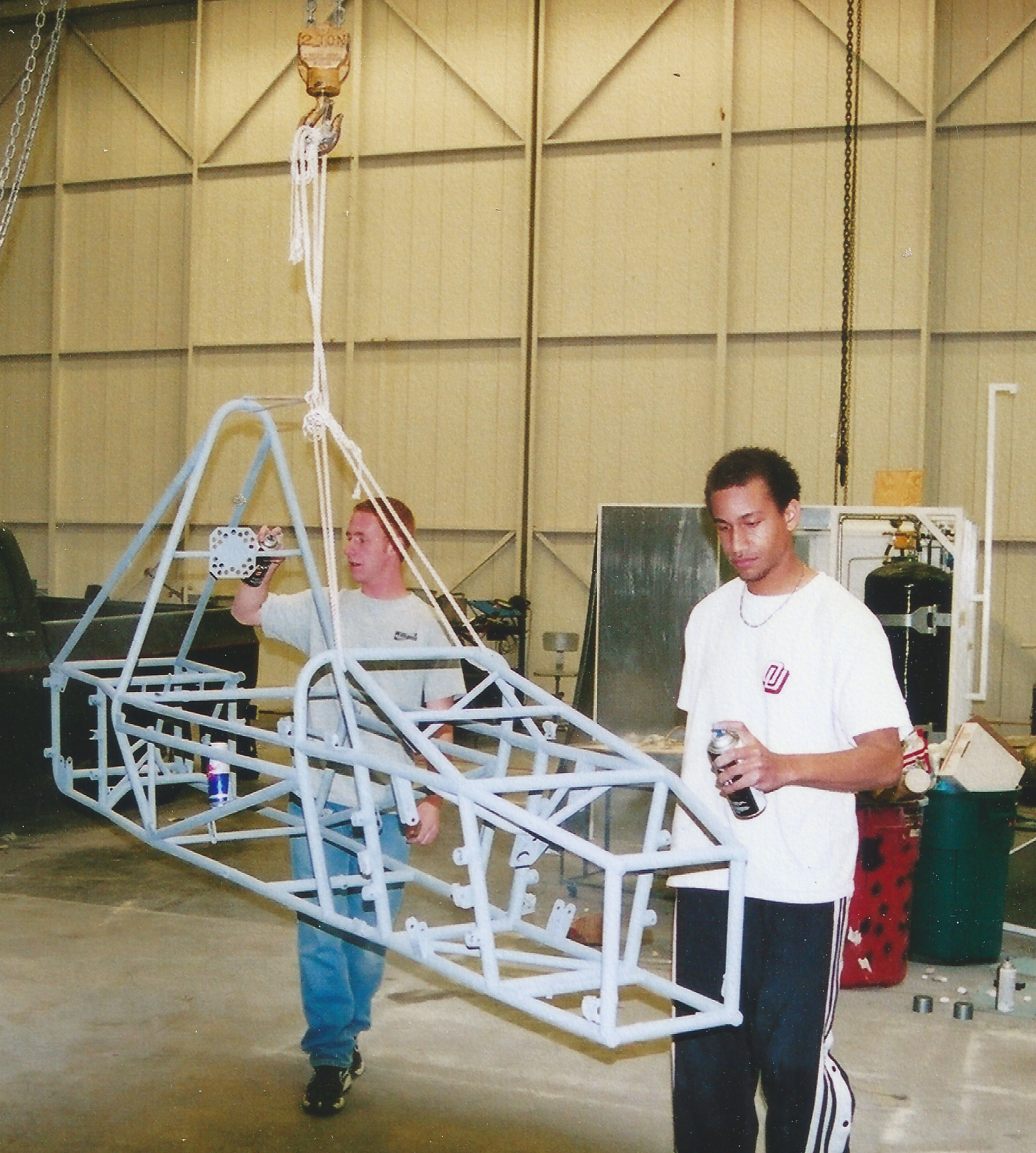 Devin (pictured right) and teammate working on the Sooner Racing Team car in 2001.