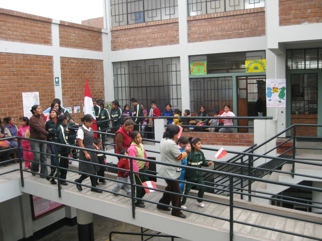 The students of Yancana Huasy are celebrating Flag Day here by parading down the stairs! This day honors those who lost in battle and celebrates the Peruvians' allegiance to the flag.
