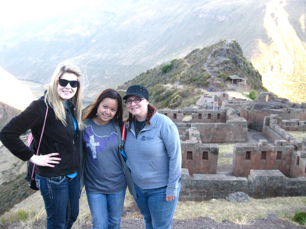We drove up the mountains and stopped twice for pictures of the Cuzco valley and Inca valley. We later climbed down Pisac (the first Inca ruins) for 2.5 hours.Left to right: Kim, Chinh (me) and Ravae took a picture in front of the Pisac ruins.