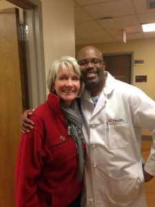 Lynne with her surgeon after being cleared to go home