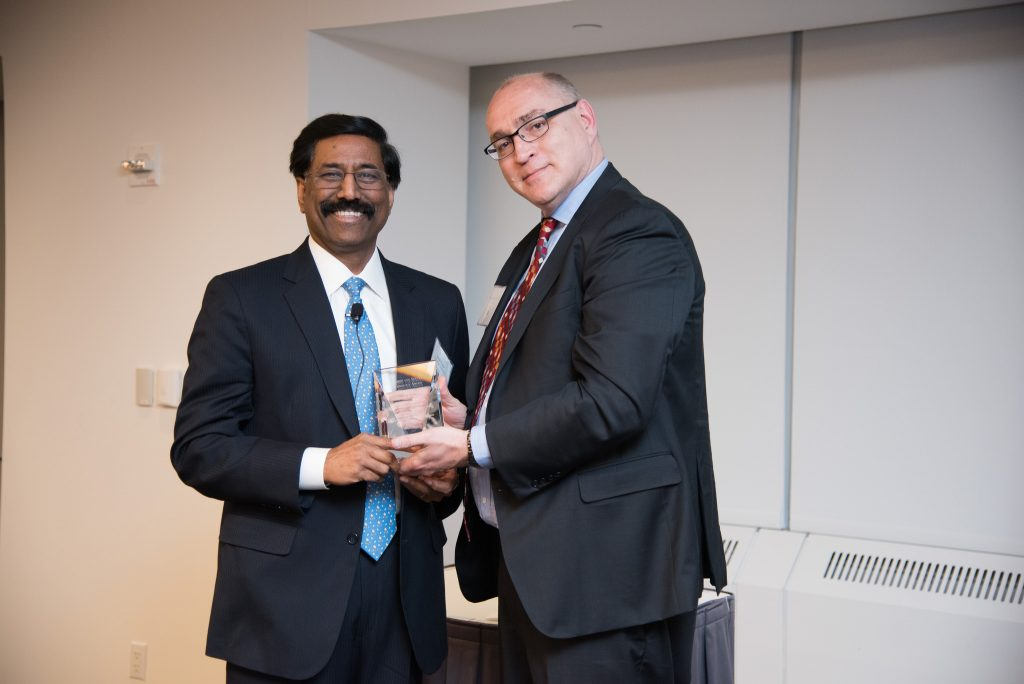 Jonathan Hill presents the Leadership and Service in Technology award to Suresh Kumar