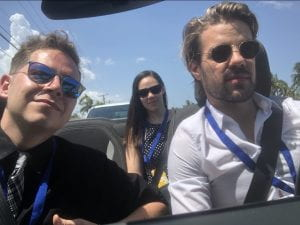 The photo itself is a selfie of three people in a car.