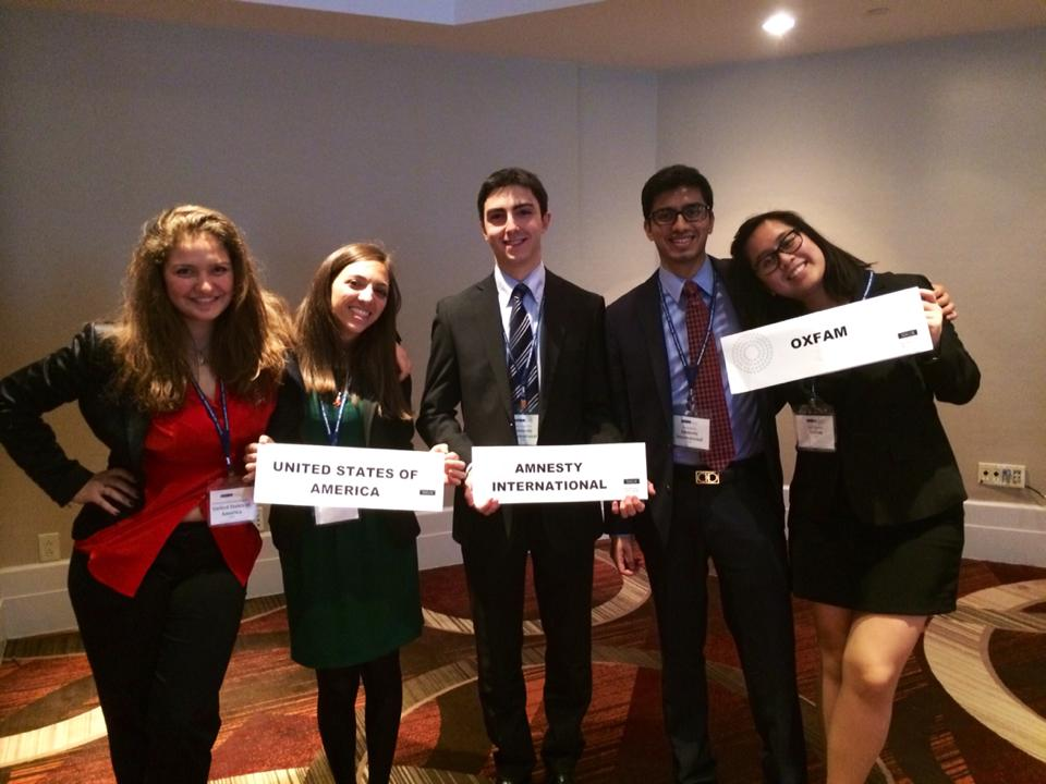 Two friends, Vato Gogsadze, Harsh Mehta and Nelli Agbulos participating in a simulation of the Commission on the Status of Women at the 2014 National Model United Nations conference in New York.