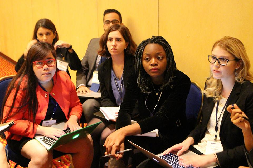 Pace University New York City students Ly Nguyen (front, left) and Kathryn Balitsos (second row, right) discuss the protection of World Heritage sites in a simulation of UNESCO at the 2015 National Model UN conference in Washington DC.