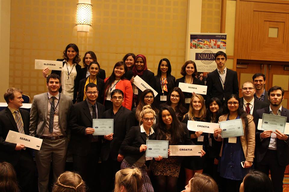 Pace University New York City Model United Nations students show off some of the seven awards they won at the 2015 National Model UN conference in Washington DC.