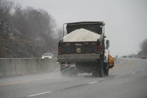 Salt truck spreading salt on icy roads