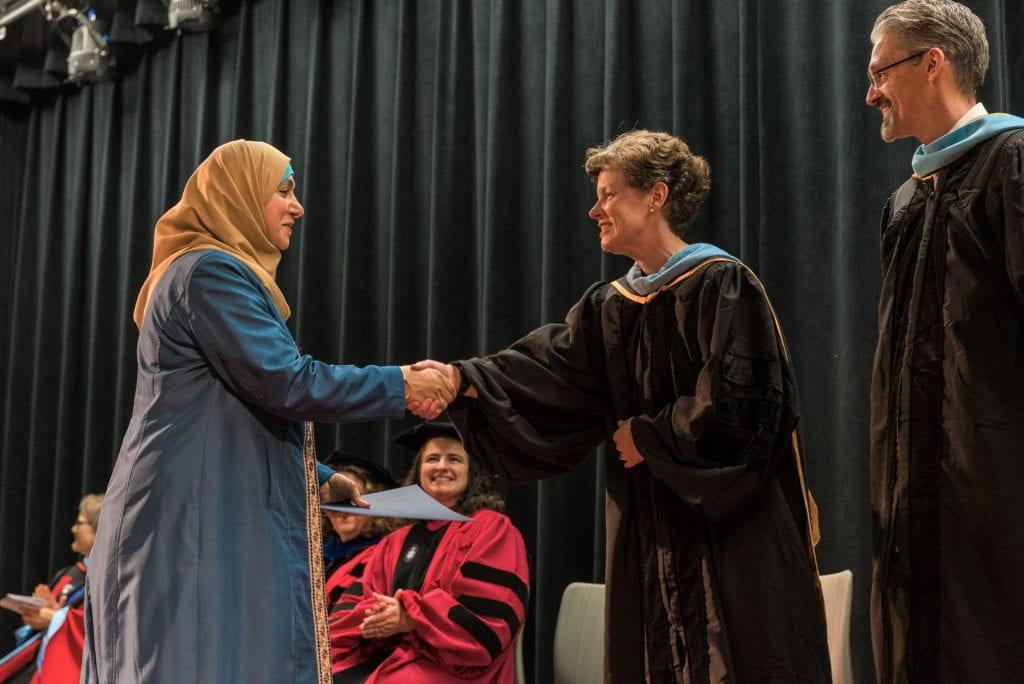 SJSU Lurie College Dean Heather Lattimer congratulates a scholar.