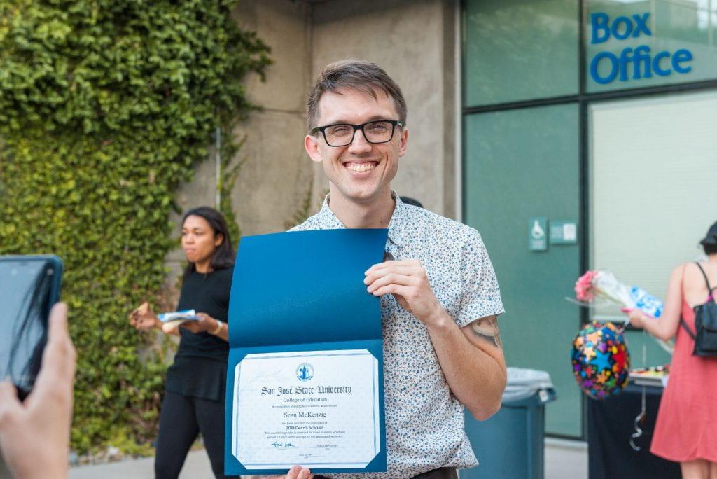 SJSU Lurie College student Sean McKenzie celebrates their Dean's Scholars honors recognition.