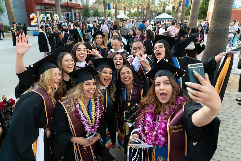 Lurie College graduates pose for a group photo