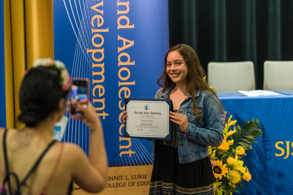 SJSU Lurie College student Adriana Garcia celebrates their Dean's Scholars honors recognition.