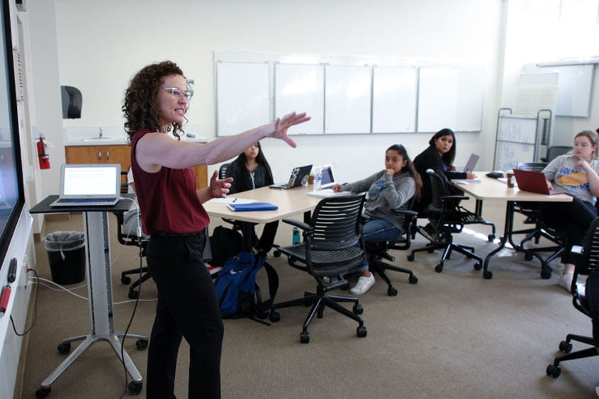 Ellen Middaugh teaching in a classroom pre-pandemic