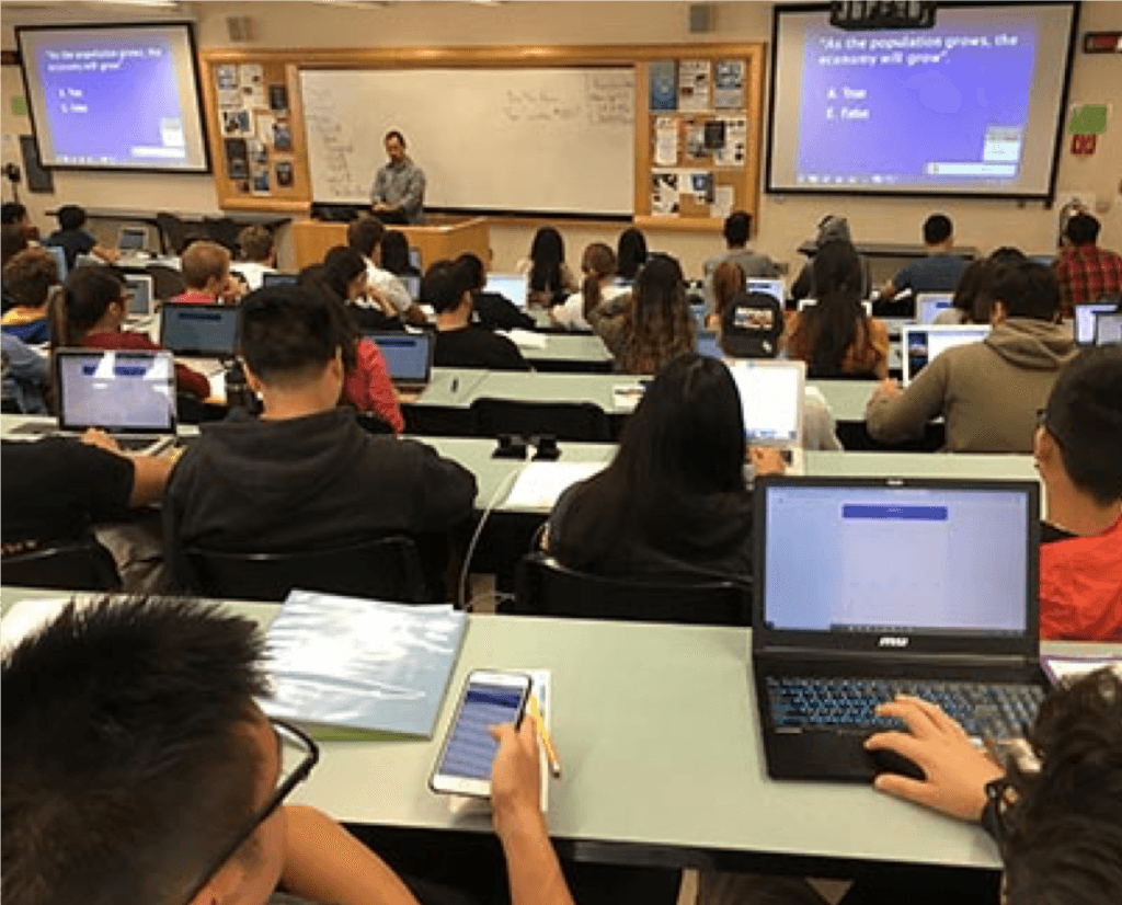 Students use their own devices when taking polls with iClicker in Professor Gregory Hanle's Economics class.