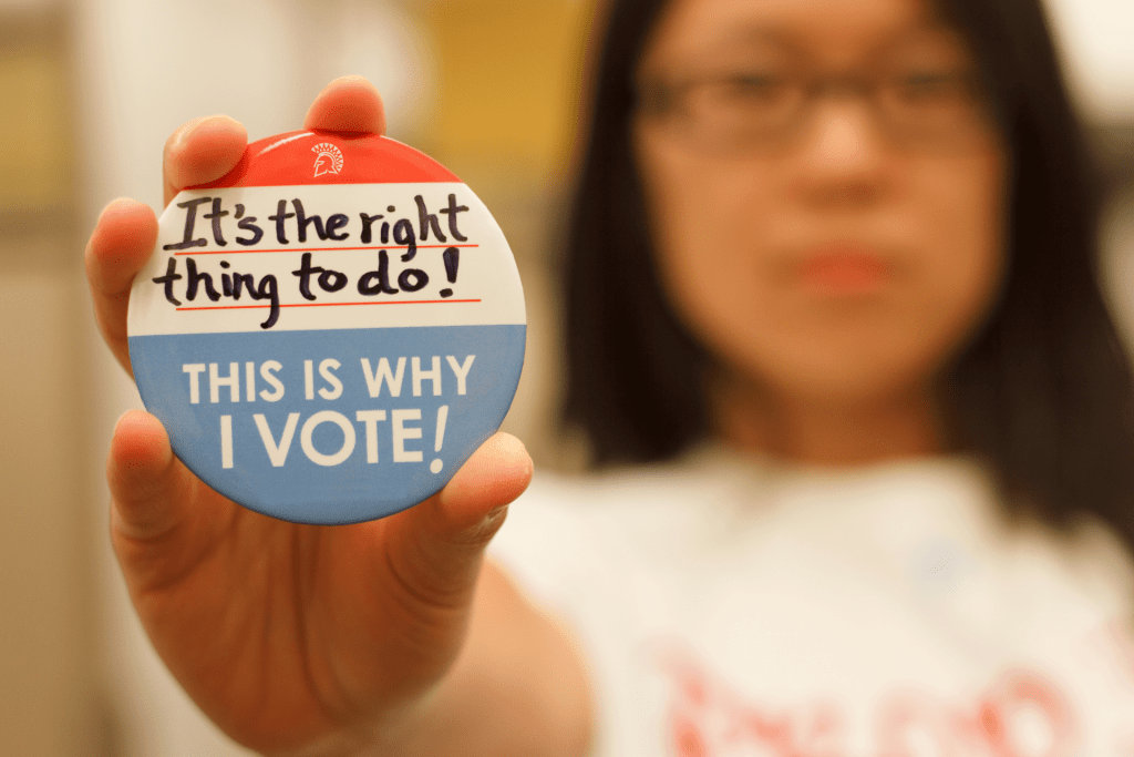 SJSU student with voting button
