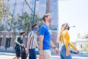 Masked SJSU students walking downtown